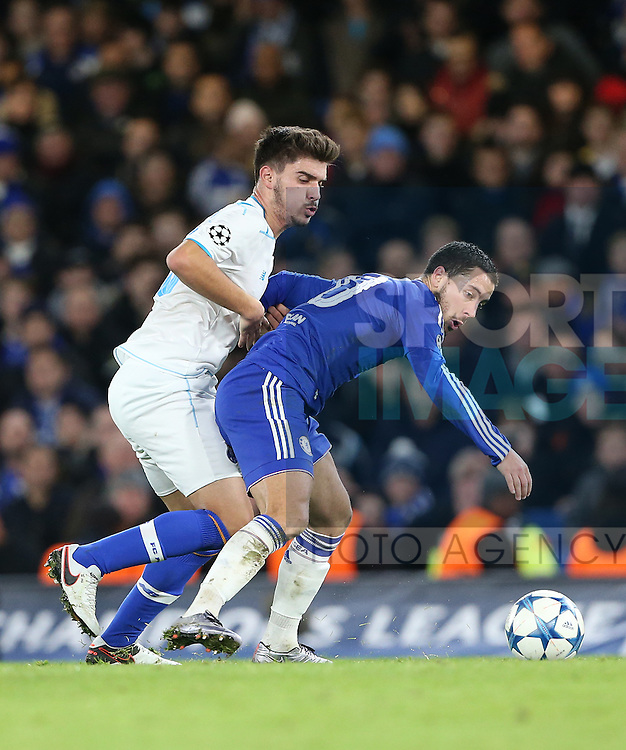 Chelsea's Eden Hazard tussles with Porto's Ruben Neves<br /> <br /> UEFA Champions League - Chelsea v FC Porto - Stamford Bridge - England - 9th December 2015 - Picture David Klein/Sportimage