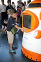 "August 01 2012, Tokyo, Japan - A kid touches the new robot guide ""Tawabo"" at Tokyo Tower. Tokyo Tower implemented the new robot guide which name is ""Tawabo"", the first indoor robot guide in Japan. It can speak Japanese, English, Chinese and Korean, it weights 200kg and it is 160cm tall."