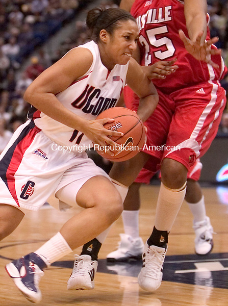 HARTFORD, CT. 05 March 2007-030507SV10--#11 Ketia Swanier of UConn drives past #25 Michelle Poindexter of Louisville during Big East semifinal tournament action at the Hartford Civic Center in Hartford Monday.<br /> Steven Valenti Republican-American