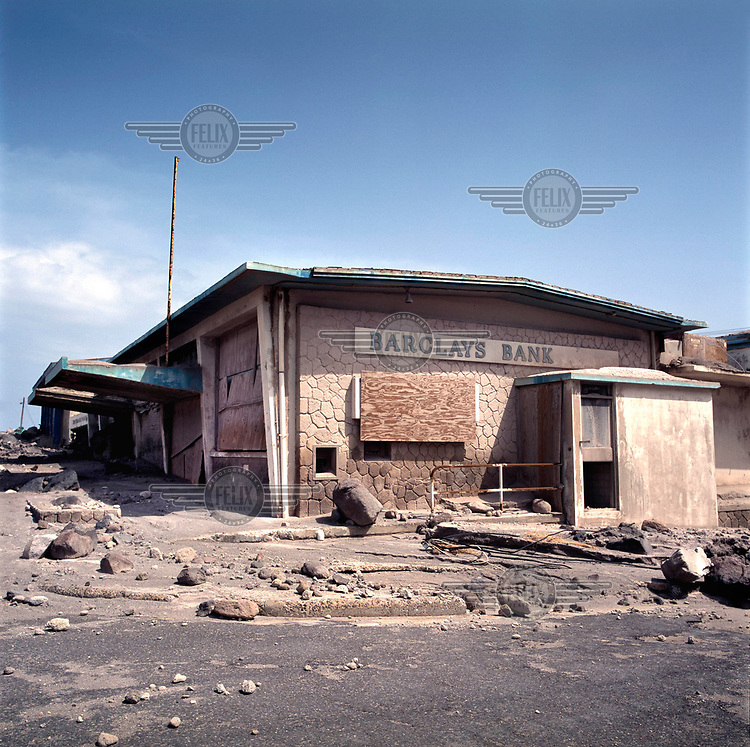 A branch of Barclays Bank surrounded by ash, mud and rock from the pyroclastic flow which descended on the former capital during the Soufriere Hills volcanic eruption. <br /> <br /> The volcano began erupting in July 1995, and remained active through the subsequent decade. Up to 7,000 of the 10,500 inhabitants have been evacuated from the island, while other residents have been moved to the northernmost areas. The southern region affected by the eruption is designated out of bounds to everyone except scientists.