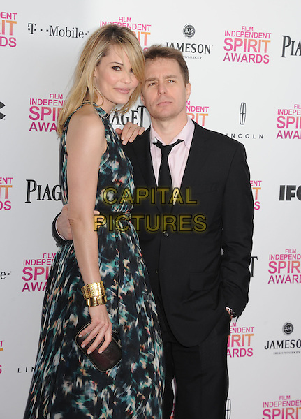 Leslie Bibb & Sam Rockwell.2013 Film Independent Spirit Awards - Arrivals Held At Santa Monica Beach, Santa Monica, California, USA,.23rd February 2013..indy indie indies indys half length white gold bracelet shirt suit tie pink dress green print   couple side .CAP/ROT/TM.©Tony Michaels/Roth Stock/Capital Pictures