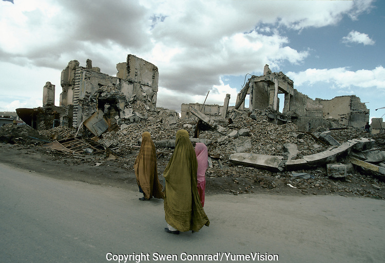 Woman in burkas, walking up what was the High Street of Kabul..The fight (1992 to 1995) between warlords Ahmad Shah Massoud of the Jamiat-e Islami and Gulbuddin Hekmatyar from the Hezb-e Islami, destroy one third of the Afghan capital.