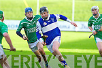 St Brendan's Cian Hussey gets away from Ballyduff's Anthony O'Carroll in the U21 hurling championship at Austin Stack Park.