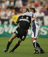 6 April 2005.  DC United's Ben Olsen (14) is held on a corner kick by Pumas UNAM midfielder Gerardo Galindo (16) during a CONCACAF Champion's Cup game at RFK Stadium in Washington, DC.