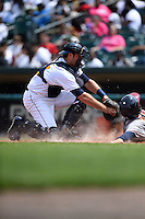 Montgomery Biscuits catcher Curt Casali (13) tags a base runner at home during a game against the Mississippi Braves on April 22, 2014 at Riverwalk Stadium in Montgomery, Alabama.  Mississippi defeated Montgomery 6-2.  (Mike Janes/Four Seam Images)