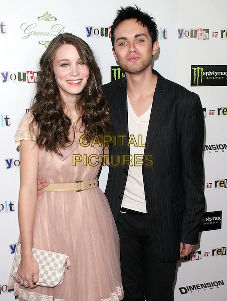 ROONEY MARA & THOMAS DEKKER .The Weinstein Company Film premiere of ''Youth In Revolt'' held at The Mann Chinese 6 Theatre in Hollywood, California, USA..January 6th, 2010.half length dress belt white check clutch bag grey gray black suit jacket top skinny thin pink beige pinstripe.CAP/RKE/DVS.©DVS/RockinExposures/Capital Pictures.