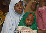 A Fulani woman and child in the Tudun-Murtala area of Kano, Nigeria wear traditional Muslim headwear.