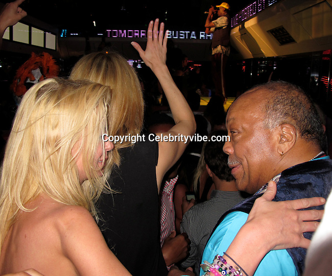 **EXCLUSIVE**.Tara Reid and Quincy Jones..VIP Room Nightclub..St. Tropez, France..Thursday, July 29, 2010..Photo ByiSnaper.com/ CelebrityVibe.com.To license this image please call (212) 410 5354; or Email:CelebrityVibe@gmail.com ;.website: www.CelebrityVibe.com.