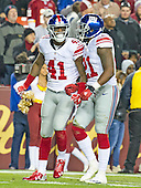 New York Giants cornerback Dominique Rodgers-Cromartie (41) celebrates his sack of Washington Redskins quarterback Kirk Cousins with strong safety Landon Collins (21) late in the second quarter at FedEx Field in Landover, Maryland on Sunday, January 1, 2017.  The Giants won the game 19 - 10.<br /> Credit: Ron Sachs / CNP<br /> (RESTRICTION: NO New York or New Jersey Newspapers or newspapers within a 75 mile radius of New York City)