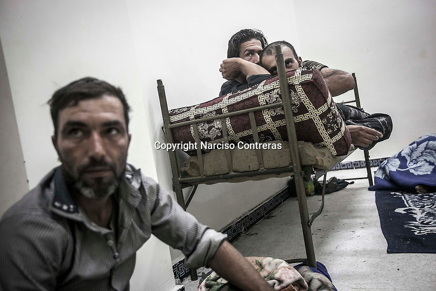A group of men stay at their cell as they are under custody by the FSA police at a makeshift prison settled in a basement of a hotel in Manbij City, located at the northeast of Aleppo province.