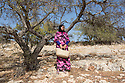 """Morocco - Tidzi - Fatima Oumissi, 32, from Idmine. Oumissi is the mother of two children, aged 12 and 6, and is currently 3-month-pregnant. The woman joined Ajddigue in 2010 in order to increase the earnings of her family. Married with a fisherman who spends most of the week far from Tidzi, Oumissi works at the cooperative only half a day, as she also has to look after the house and bring her kids to school. """"I like to work here and spend time with other women"""" she explain. """"We talk about our problems and have fun together. There is a lot of complicity."""""""