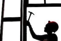 Construction illustration of a woman hammering. Silhouette. PHOTOS BY:PATRICK SCHNEIDER PHOTO.COM