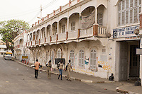 Senegal, Saint Louis.  French Colonial-era Architecture.  Young Female Students Walking.