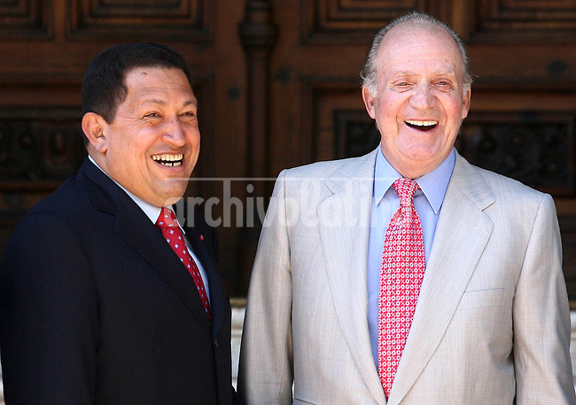 President of Venezuela Hugo Chavez smiles next to King of Spain, Juan Carlos de Borbon, in Madrid.