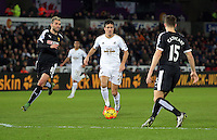 Jack Cork of Swansea (C) against Valon Behrami (L) and Craig Cathcart of Watford (R) during the Barclays Premier League match between Swansea City and Watford at the Liberty Stadium, Swansea on January 18 2016