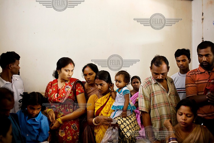People queue to see a doctor in a clinic in Orissa state.
