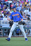 OMAHA, NE - JUNE 26: Brady Singer (51) of the University of Florida cheers after striking out a Louisiana State University batter during the Division I Men's Baseball Championship held at TD Ameritrade Park on June 26, 2017 in Omaha, Nebraska. The University of Florida defeated Louisiana State University 4-3 in game one of the best of three series. (Photo by Jamie Schwaberow/NCAA Photos via Getty Images)