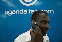 "Demonstrating the 'Kasana' or Sun, a solar powered phone - ""No Power No Worries"" read the adverts. Available from Uganda Telecom,they've had equiries from Rwandans who want to use their phone. RTE, the Chinese manufacturer claims that 18 hours of bright sun will provide a full recharge."