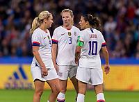 LE HAVRE,  - JUNE 20: Lindsey Horan #9, Sam Mewis #3 and Carli Lloyd #10 confer during a game between Sweden and USWNT at Stade Oceane on June 20, 2019 in Le Havre, France.