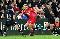Paul Asquith of the Scarlets (C) is pulled back by Jeff Hassler of the Ospreys (R) during the Guinness PRO14 Round 6 match between Ospreys and Scarlets at The Liberty Stadium , Swansea, Wales, UK. Saturday 07 October 2017