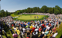 Wide angle view showing the crowds gathered around a green during the 2007 Wachovia Championships at Quail Hollow Country Club in Charlotte, NC.
