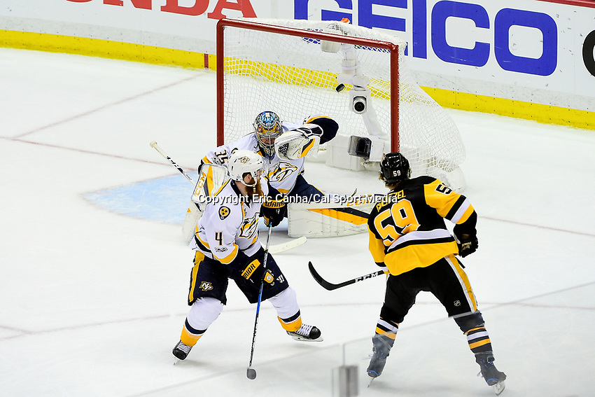 May 29, 2017: Pittsburgh Penguins center Jake Guentzel (59) scores against Nashville Predators goalie Pekka Rinne (35)  during game one of the National Hockey League Stanley Cup Finals between the Nashville Predators  and the Pittsburgh Penguins, held at PPG Paints Arena, in Pittsburgh, PA. Pittsburgh defeats Nashville 5-3 in regulation time.  Eric Canha/CSM