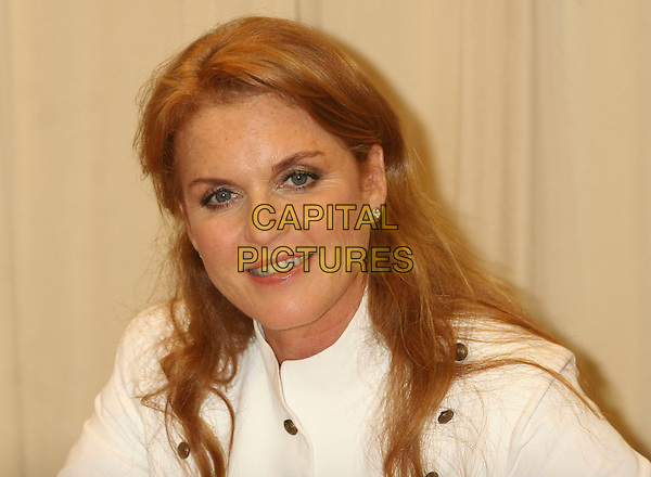 "SARAH FERGUSON - DUCHESS OF YORK .Signs her children's book ""Little Red's Summer Adventure"" at Barnes & Noble, New York, NY, USA. .June 27th, 2006.Ref: IW.headshot portrait brass buttons.www.capitalpictures.com.sales@capitalpictures.com.©Capital Pictures"