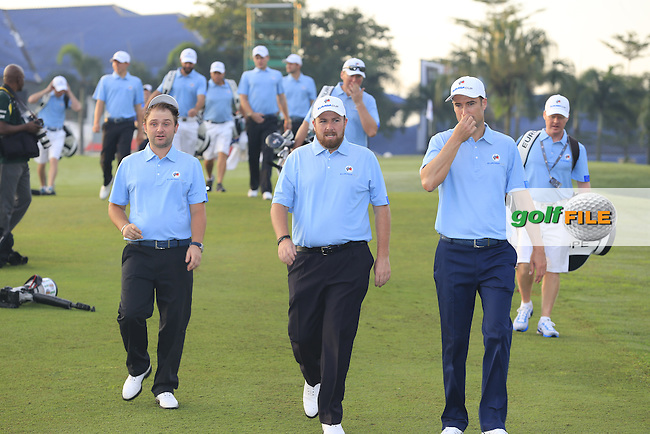 Andy Sullivan, Shane Lowry and Ross Fisher make their way to the European Team photo before Pro-Am Day of the 2016 Eurasia Cup held at the Glenmarie Golf &amp; Country Club, Kuala Lumpur, Malaysia. 14th January 2016.<br /> Picture: Eoin Clarke | Golffile<br /> <br /> <br /> <br /> All photos usage must carry mandatory copyright credit (&copy; Golffile | Eoin Clarke)