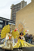 Parade passes Trellick Tower during Notting Hill Carnival, London