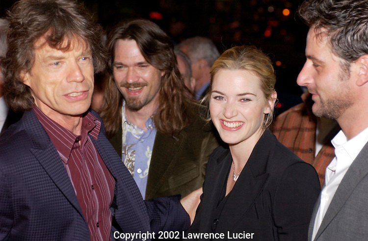 Rock superstar Mick Jagger and actors Dougray Scott, Kate Winslett, and Jeremy Northrup celebrate at the benefit premier of the film Enigma April 11, 2002, in New York.  The benefit supports the International Rescue Committee which provides emergency and long term aid to refugees in over 30 countries..