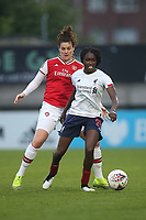 Jennifer Beattie of Arsenal and Rinsola Babajide of Liverpool during Arsenal Women vs Liverpool Women, Barclays FA Women's Super League Football at Meadow Park on 24th November 2019
