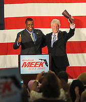 """SMG_Bill Clinton_Kendrick Meek_DavieRally_081610_01.JPG<br /> <br /> DAVIE, FL - AUGUST 16:  Former President Bill Clinton urged Democrats to support Kendrick Meek in next week's Senate primary and pleaded with frustrated Americans to give Democrats more time to address the country's economic woes.  """"I love Kendrick Meek,"""" Clinton told a crowd of about 1,000 at a sweltering gymnasium in Davie   Clinton's visit highlights a circling of Democratic Party establishment wagons for four-term Miami U.S. Rep. Meek as he faces a tough primary against billionaire Palm Beach investor Jeff Greene.  On August 16, 2010 at the Signature Grand Hotel in Davie,  Florida.    (Photo By Storms Media Group)<br /> <br /> <br /> People:  Bill Clinton_Kendrick Meek<br /> <br /> Must call if interested<br /> Michael Storms<br /> Storms Media Group Inc.<br /> 305-632-3400 - Cell<br /> 305-513-5783 - Fax<br /> MikeStorm@aol.com"""