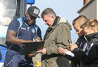 Adebayo Akinfenwa of Wycombe Wanderers signs autographs for a supporter as he arrives at the Sky Bet League 2 match between Grimsby Town and Wycombe Wanderers at Blundell Park, Cleethorpes, England on 4 March 2017. Photo by Andy Rowland / PRiME Media Images.