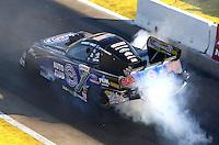Aug 15, 2014; Brainerd, MN, USA; NHRA funny car driver Robert Hight during qualifying for the Lucas Oil Nationals at Brainerd International Raceway. Mandatory Credit: Mark J. Rebilas-USA TODAY Sports