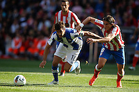 02.05.2012 SPAIN -  La Liga matchday 20th  match played between Atletico de Madrid vs Real Sociedadl (1-1) at Vicente Calderon stadium. The picture show Xabier Prieto Argarate (Midfielder of Real Sociedad) and Filipe Luis Karsmirski (Brazilian defender of At. Madrid)