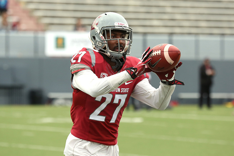 Marcellus Pippens warms up prior to the annual Washington State Cougar spring game, the Crimson and Gray game, at Joe Albi Stadium in Spokane, Washington, on April 23, 2016.