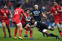 Maxime Medard of Toulouse is tackled by Semesa Rokoduguni of Bath Rugby. Heineken Champions Cup match, between Stade Toulousain and Bath Rugby on January 20, 2019 at the Stade Ernest Wallon in Toulouse, France. Photo by: Patrick Khachfe / Onside Images