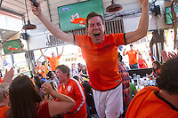 San Francisco, CA - Sunday, June 29, 2014: Dutch fans celebrate at the SOMA StrEat Food Park Netherlands victory vs. Mexico round of 16 World Cup match.