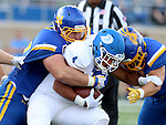 BROOKINGS, SD - SEPTEMBER 10:  Kellen Soulek #94 from South Dakota State brings down Conley Wilkins #4 from Drake during their game at the Dana J. Dykhouse Stadium Saturday night in Brookings. (Photo by Dave Eggen/Inertia)