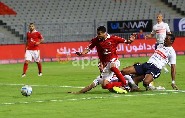 """Al Ahly players compete against with Zamalek players during their Egyptian Premier League derby soccer match at Borg El Arab """"Army Stadium"""" near Alexandria, Egypt, February 9, 2016. Photo by Amr Sayed"""