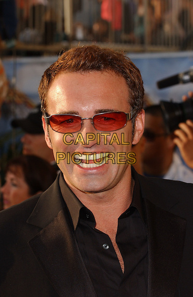 JULIAN McMAHON.Attends The 2005 MTV Movie Awards held at The Shrine Theatre in Los Angeles, California, USA, .June 4th 2005..portrait headshot red tinted sunglasses.Ref: DVS.www.capitalpictures.com.sales@capitalpictures.com.©Debbie VanStory/Capital Pictures