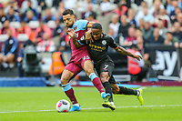 Ryan Fredericks of West Ham United and Raheem Sterling of Manchester Cityduring the Premier League match between West Ham United and Manchester City at the London Stadium, London, England on 10 August 2019. Photo by David Horn.