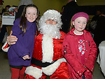 Emma O'Boyle and Alana Farrell pictured with Santa at the christmas craft fair in Clogherhead community hall. Photo:Colin Bell/pressphotos.ie