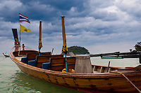 Empty longtail boat in the sea in nasty weather in Phuket, Thailand