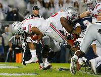 Ohio State Buckeyes running back J.K. Dobbins (2) falls into the endzone for a 4-yard touchdown during the third quarter of the NCAA football game against the Penn State Nittany Lions at Beaver Stadium in University Park, Pa. on Sept. 29, 2018. The Buckeyes won 27-26. [Adam Cairns / Dispatch]