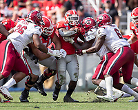 ATHENS, GA - OCTOBER 12: D'Andre Swift #7 of the Georgia Bulldogs is stopped by multiple South Carolina defenders during a game between University of South Carolina Gamecocks and University of Georgia Bulldogs at Sanford Stadium on October 12, 2019 in Athens, Georgia.