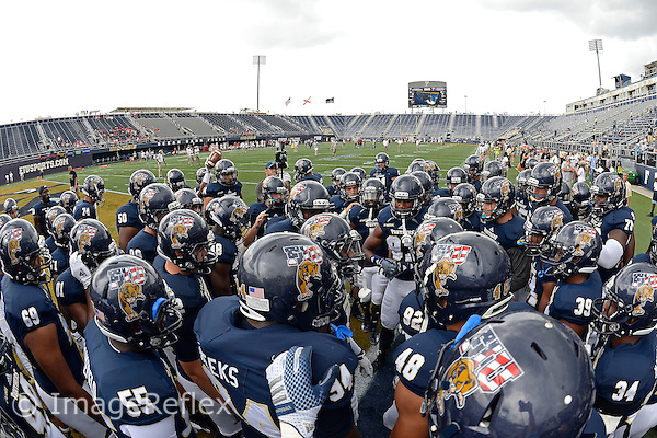 20 September 2014:  FIU's team prepares to take the field prior to the game as the University of Louisville Cardinals defeated the FIU Golden Panthers, 34-3, at FIU Stadium in Miami, Florida.