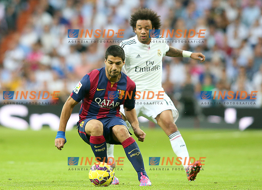 Real Madrid's Marcelo Vieira (r) and FC Barcelona's Luis Suarez during La Liga match.October 25,2014. (ALTERPHOTOS/Acero) <br /> Clasico<br /> Foto Insidefoto