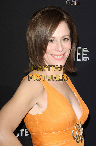 JANE KACZMAREK.11th Annual Costume Designers Guild Awards held at The Four Season Beverly Wilshire Hotel, Beverly Hills, California, USA..February 17th, 2009.half length low cut neckline orange gold brooch.CAP/ADM/KB.©Kevan Brooks/AdMedia/Capital Pictures.