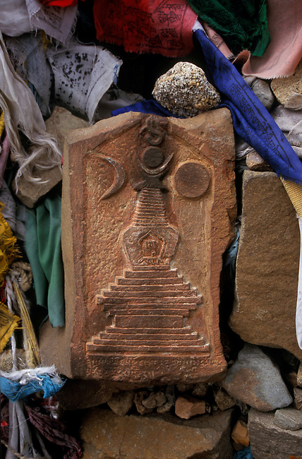 CARVED STONE STUPA on a MANI WALL at MOUNT KAILASH which is sacred to BUDDHIST & HINDU PILGRIMS - TIBET